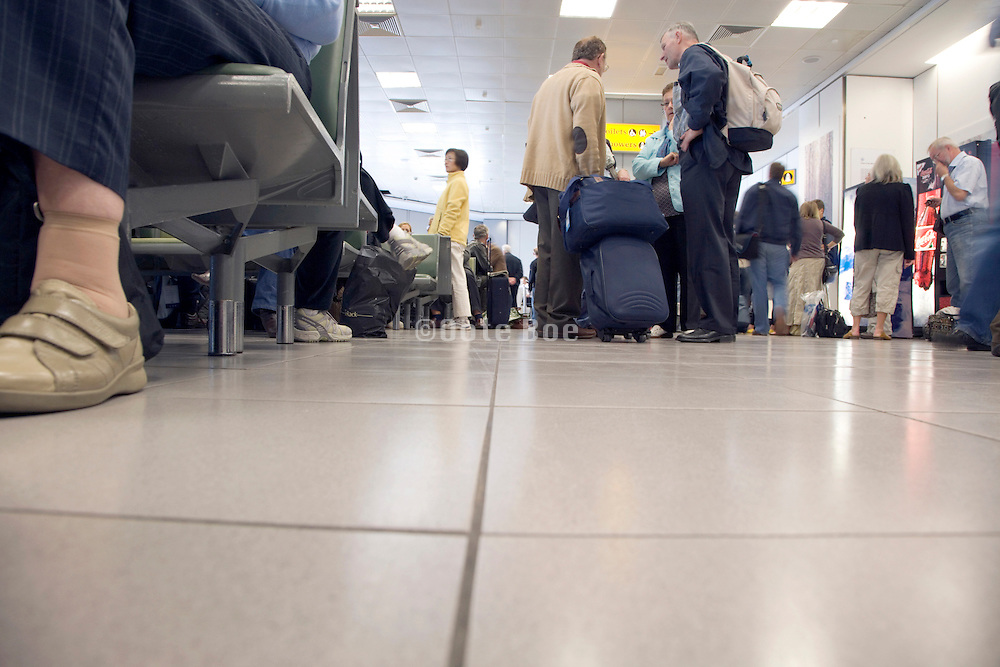 people waiting for a delayed airplane at the boarding gate