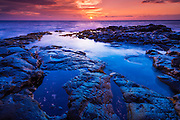 Sunset and tide pool above the Pacific, Kailua-Kona, Hawaii USA
