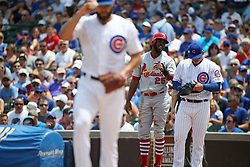 July 21, 2017 - Chicago, IL, USA - The St. Louis Cardinals' Dexter Fowler (25) and Chicago Cubs first baseman Anthony Rizzo talk as Cubs starting pitcher Jake Arrieta stands on the mound in the first inning on Friday, July 21, 2017, at Wrigley Field in Chicago. The Cards won, 11-4. (Credit Image: © John J. Kim/TNS via ZUMA Wire)