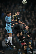 Leroy Sané (Manchester City) and Mikael Lustig (Celtic) both jump to win the header during the Champions League match between Manchester City and Celtic at the Etihad Stadium, Manchester, England on 6 December 2016. Photo by Mark P Doherty.