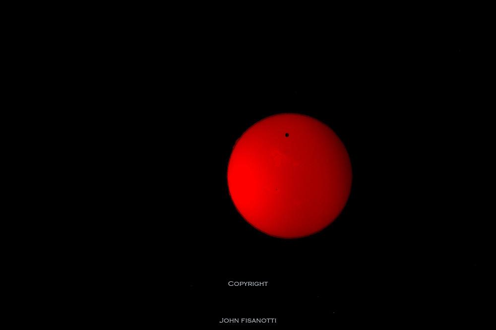 Venus transiting the sun  on June 5, 2012, photographed in Hydrogen Alpha (Ha) light