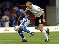 Photo: Kevin Poolman.<br />Luton Town v Leicester City. Coca Cola Championship.<br />05/08/2006. <br />Leicester's Darren Kenton (L) and Warren Feeney of Luton battle for the ball.