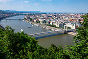 The Danube river in Budapest with three of it's famous bridges and parliament building in the distance, Hungary