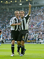 Photo: Andrew Unwin.<br /> Newcastle United v Manchester City. The Barclays Premiership. 24/09/2005.<br /> Newcastle's Michael Owen (R) celebrates his first goal at St James' Park with Lee Bowyer (L).