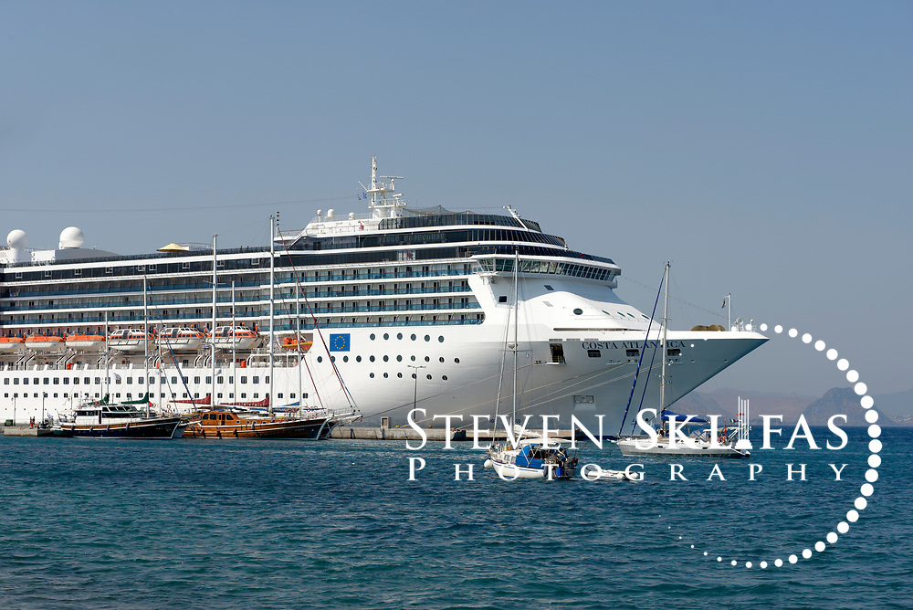 The cruise ship Costa Atlantica anchored in the harbor of Kos town, the capital of the Greek island of Kos. Kos is part of the Dodecanese island group and birthplace of the ancient physician and father of medicine, Hippocrates.