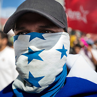 A demonstrator in Tegucigalpa covered his face with the Honduran flag.