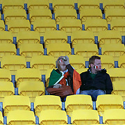 Irish fans contemplate their teams loss after the Ireland V Wales Quarter Final match at the IRB Rugby World Cup tournament. Wellington Regional Stadium, Wellington, New Zealand, 8th October 2011. Photo Tim Clayton...