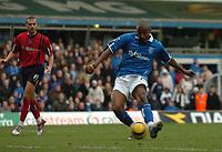 Fotball<br /> Premier League England 2004/2005<br /> 18.12.2004<br /> Foto: SBI/Digitalsport<br /> NORWAY ONLY<br /> <br /> Birmingham City v West Bromwich Albion<br /> Barclays Premiership. 18/12/2004<br /> <br /> Birmingham City's Clinton Morrison (R) scores his side's second goal as West Brom's Neil Clement looks on helplessly.