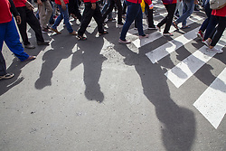 May 1, 2019 - Central Jakarta, Jakarta, Indonesia - Jakarta, 01 May 2019 : Shadow of the labors during the demonstration. Thousands of Labor filled Merdeka Barat Street Jakarta celebrating May Day. They demanding rise wage for labor in Indonesia, police blockad road to Indonesian Palace making labor only can held the event 3 km from the palace. (Credit Image: © Donal Husni/ZUMA Wire)