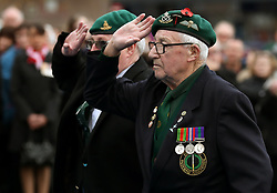 A Commando veteran salutes during a remembrance service in Fort William on the 100th anniversary of the signing of the Armistice which marked the end of the First World War.