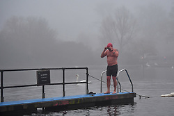 © Licensed to London News Pictures. 30/12/2016. London, UK.   Swimmers in the serpentine lake, surrounded by fog in Hyde Park central London at sunrise on another freezing winter morning.. Photo credit: Ben Cawthra/LNP