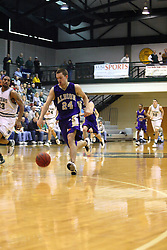 30 December 2006: Dean Raven strolls up court on a quick break. The Titans outscored the Britons by a score of 94-80. The Britons of Albion College visited the Illinois Wesleyan Titans at the Shirk Center in Bloomington Illinois.<br />