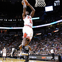 29 January 2012: Chicago Bulls shooting guard Ronnie Brewer (11) goes for the dunk on a fastbreak during the Miami Heat 97-93 victory over the Chicago Bulls at the AmericanAirlines Arena, Miami, Florida, USA.
