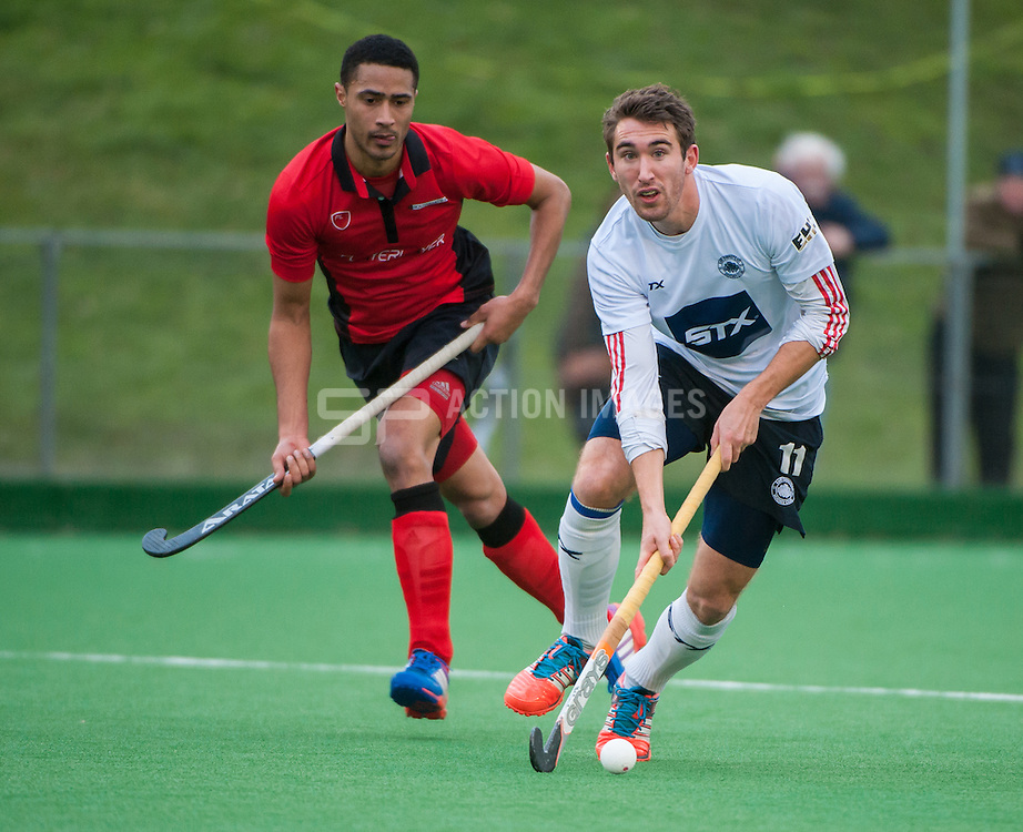 East Grinstead's David Condon is watched by Darren Cheesman of Southgate. Southgate v East Grinstead - Now: Pensions Hockey League Premier Division, Trent Park, London, UK on 01 February 2015. Photo: Simon Parker