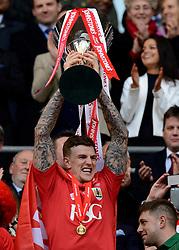 Bristol City's Aden Flint lifts the JPT Trophy  - Photo mandatory by-line: Joe Meredith/JMP - Mobile: 07966 386802 - 22/03/2015 - SPORT - Football - London - Wembley Stadium - Bristol City v Walsall - Johnstone Paint Trophy Final