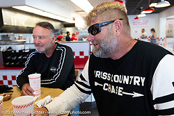 Marty Patterson (R) and Brian Doerfler having their last lunch in 5-Guys during the Cross Country Chase motorcycle endurance run from Sault Sainte Marie, MI to Key West, FL. (for vintage bikes from 1930-1948). Stage-10 covered 110 miles from Miami to the finish in Key West, FL USA. Sunday, September 15, 2019. Photography ©2019 Michael Lichter.