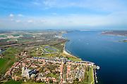 Nederland, Zeeland, Gemeente Veere 01-04-2016; Veere, voormalige visserplaats, gelegen aan het Veerse Meer. Dit meer is ontstaan door de afdamming van het Veerse Gat in het kader van de Deltawerken waardoor Veere niet langer een verbinding heeft met de Noordzee. Veerse Gatdam aan de horizon.<br /> <br /> luchtfoto (toeslag op standard tarieven);<br /> aerial photo (additional fee required);<br /> copyright foto/photo Siebe Swart