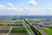 Nederland, Flevoland, Gemeente Noordoostpolder, 07-05-2015; Rijksweg A6 ter hoogte van Bant, Emmeloord aan de horizon.<br /> Motorway through the new polder Noordoostpolder.<br /> luchtfoto (toeslag op standard tarieven);<br /> aerial photo (additional fee required);<br /> copyright foto/photo Siebe Swart