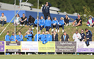 Brighton and Hove Albion ladies team watching during the FA Vase 1st Qualifying Round match between Worthing United and East Preston FC at the Robert Eaton Memorial Ground, Worthing, United Kingdom on 6 September 2015. The first home match for Worthing United since losing team mates Matthew Grimstone and Jacob Schilt in the Shoreham air show disaster.