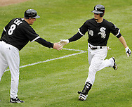 CHICAGO - MAY 21:  Brent Lillibridge #18 is greeted by third base coach Jeff Cox #8 of the Chicago White Sox after Lillibridge hit a home run in the seventh inning during the game against the Los Angeles Dodgers on May 21, 2011 at U.S. Cellular Field in Chicago, Illinois.  The White Sox defeated the Dodgers 9-2.  (Photo by Ron Vesely)  Subject:   Brent Lillibridge;Jeff Cox