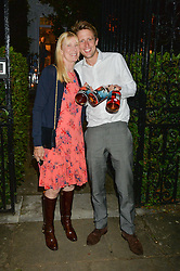 LADY CARINA FROST and her son GEORGE FROST attending Annabel Goldsmith's Summer party held at her home in Ham, Surrey on 10th July 2014.