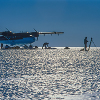 """A survey team travelling in a Twin Otter ski plane scouts for a bare-ice landing strip for wheeled C-130 aircraft at a site that will later be named """"Blue One,""""  near the Fenris Mountains in Queen Maud Land."""