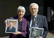 Garden City, New York, U.S. November 14, 2019. L-R, MICHELE MASON, of Manhattan, and ALAN CONTESSA each hold a photo related to Apollo 10 Commander Lt. Gen. Thomas Stafford at the 17th Annual Cradle of Aviation Museum Air and Space Gala. Stafford held the photo Stafford sent her when she wrote to him once he was inducted to NASA class of 1962 astronauts. Contessa held photo Stafford autographed for him.