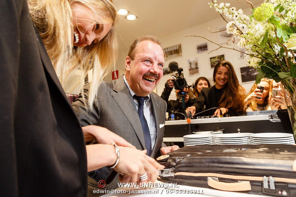 NLD/Amsterdam/20160223 - Opening 1e brandstore Rimowa, Romee Strijd en ............. snijden de taart aan als openingshandeling