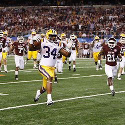 Jan 7, 2011; Arlington, TX, USA; LSU Tigers running back Stevan Ridley (34) runs for a touchdown during the second quarter of the 2011 Cotton Bowl against the Texas A&M Aggies at Cowboys Stadium.  Mandatory Credit: Derick E. Hingle