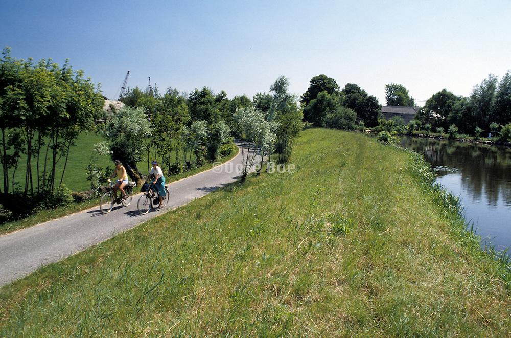couple biking along countryside