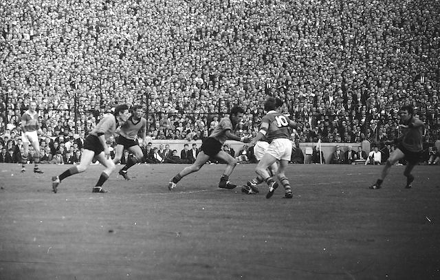 Kerry player kicks the ball clear down pitch during the All Ireland Senior Gaelic Football Final Kerry v Down in Croke Park on the 22nd September 1968. Down 2-12 Kerry 1-13.