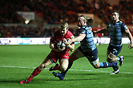 Jonathan Evans of the Scarlets beats Kristian Dacey and Josh Navidi of the Cardiff Blues ® as he  scores a try in the 2nd half. Guinness Pro14 rugby match, Scarlets v Cardiff Blues  at the Parc y Scarlets in Llanelli, West Wales on Saturday 28th October 2017.<br /> pic by  Andrew Orchard, Andrew Orchard sports photography.