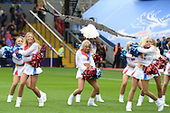 the Crystal Palace Eagle flies just inches over the heads of the worried looking Crystal Girls cheerleaders as they perform before k/o.  Barclays Premier league match, Crystal Palace v Arsenal at  Selhurst Park in London on Sunday 16th August 2015.<br /> pic by John Patrick Fletcher, Andrew Orchard sports photography.