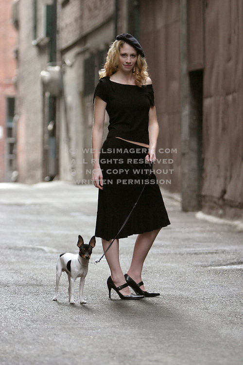 Image of woman walking dog in Pioneer Square, Seattle, Washington, Pacific Northwest by Randy Wells