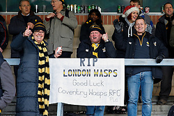 A group of Wasps supporters display a banner showing their dislike of the club's move to the Ricoh Arena in Coventry after this match - Photo mandatory by-line: Rogan Thomson/JMP - 07966 386802 - 14/12/2014 - SPORT - RUGBY UNION - High Wycombe, England - Adams Park Stadium - Wasps v Castres Olympique - European Rugby Champions Cup Pool 2.