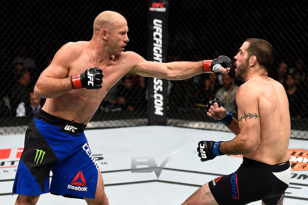 TORONTO, CANADA - DECEMBER 10:  (L-R) Donald Cerrone punches Matt Brown in their welterweight bout during the UFC 206 event inside the Air Canada Centre on December 10, 2016 in Toronto, Ontario, Canada. (Photo by Jeff Bottari/Zuffa LLC/Zuffa LLC via Getty Images)