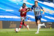 20th June 2020, American Express Stadium, Brighton, Sussex, England: Premier League football, Brighton v Arsenal.<br /> Nicolas Pepe challenges Dan Burn.