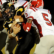Topsail's Wayland Batson is tackled by Jacksonville's Aaron Williams. (Jason A. Frizzelle)