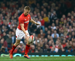 Gareth Anscombe of Wales kicks through<br /> <br /> Photographer Simon King/Replay Images<br /> <br /> Six Nations Round 3 - Wales v England - Saturday 23rd February 2019 - Principality Stadium - Cardiff<br /> <br /> World Copyright © Replay Images . All rights reserved. info@replayimages.co.uk - http://replayimages.co.uk