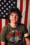 """A young woman war games paintball combatant at Sad Sack's Paintball Park, near Los Angeles, California, USA. Her T-shirt reads: """"Join the Marines. Travel to exotic distant lands. Meet exciting, unusual people. And kill them."""" MODEL RELEASED."""