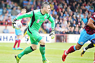 Scunthorpe United's Matt Gilks(1) rolls the ball out during the EFL Sky Bet League 1 match between Scunthorpe United and Rotherham United at Glanford Park, Scunthorpe, England on 12 May 2018. Picture by Nigel Cole.