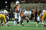 AUSTIN, TX - OCTOBER 18:  Tyrone Swoopes #18 of the Texas Longhorns reads the defense against the Iowa State Cyclones on October 18, 2014 at Darrell K Royal-Texas Memorial Stadium in Austin, Texas.  (Photo by Cooper Neill/Getty Images) *** Local Caption *** Tyrone Swoopes