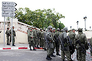 Tunis, Tunisia. January 25th 2011.The army at the entrance of the Kasbah Square where people protest outside the Prime Minister's office (Mohammed Ghannouchi). Protesters demand the removal of members of the ousted president's regime (Zine El Abidine Ben Ali) still in the government....