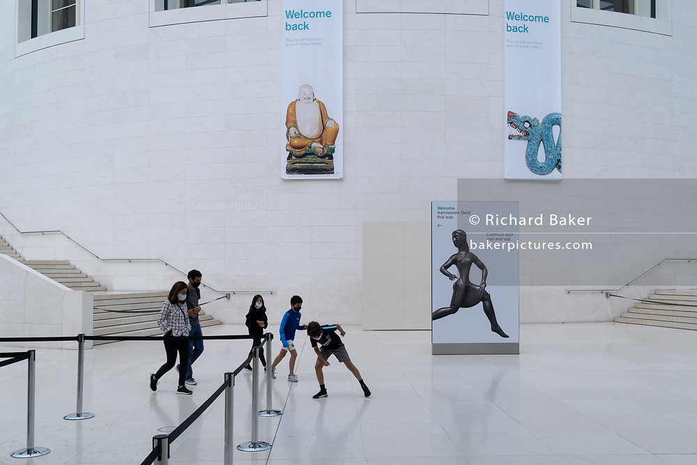 Now re-opened after months of closure during the Coronavirus pandemic, some of the first visitors who have pre-booked free tickets, once again enjoy the historical artifacts at the British Museum, on 2nd September 2020, in London, England.