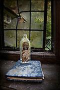 Empty glycerin bottle on book