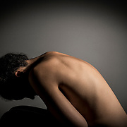 A shot of a bare skinned, models back photographed as part of a healthcare campaign.