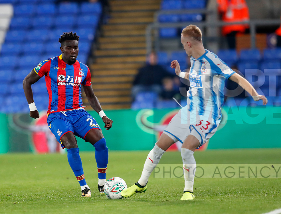 Crystal Palace's Pape Souare tussles with Huddersfield's Florent Hadergjonaj during the Carabao cup match at Selhurst Park Stadium, London. Picture date 19th September 2017. Picture credit should read: David Klein/Sportimage