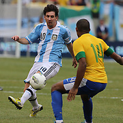 Lionel Messi, Argentina, flicks the ball past Juan, Brazil, during the Brazil V Argentina International Football Friendly match at MetLife Stadium, East Rutherford, New Jersey, USA. 9th June 2012. Photo Tim Clayton
