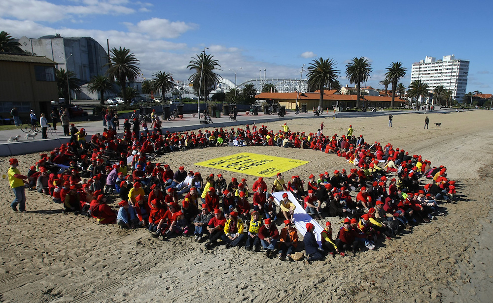 Amnesty International, Get Up!, the Refugee Council of Australia and hundreds of Melbourne residents form a giant red and white human life ring on St Kilda Beach. They aim to show politicians that Australians believe in saving lives by helping refugees fleeing war and persecution.    08/05/2010 Pic By Craig Sillitoe melbourne photographers, commercial photographers, industrial photographers, corporate photographer, architectural photographers, This photograph can be used for non commercial uses with attribution. Credit: Craig Sillitoe Photography / http://www.csillitoe.com<br /> <br /> It is protected under the Creative Commons Attribution-NonCommercial-ShareAlike 4.0 International License. To view a copy of this license, visit http://creativecommons.org/licenses/by-nc-sa/4.0/.