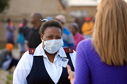KRUGERSDORP, SOUTH AFRICA - APRIL 08: A health official responds to interview questions at a Covid19 screening centre in the Munsieville suburb on April 08, 2020 in Krugersdorp, Mogale South Africa. Under pressure from a global pandemic. President Ramaphosa declared a 21 day national lockdown, mobilising goverment structures accross the nation to combat the rapidly spreading COVID-19 virus, or Coronavirus. The lockdown requires businesses to close and the public to stay at home during this period, unless part of approved essential services.(Photo by  Dino Lloyd)